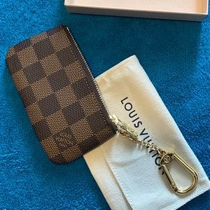 Louis Vuitton key pouch.